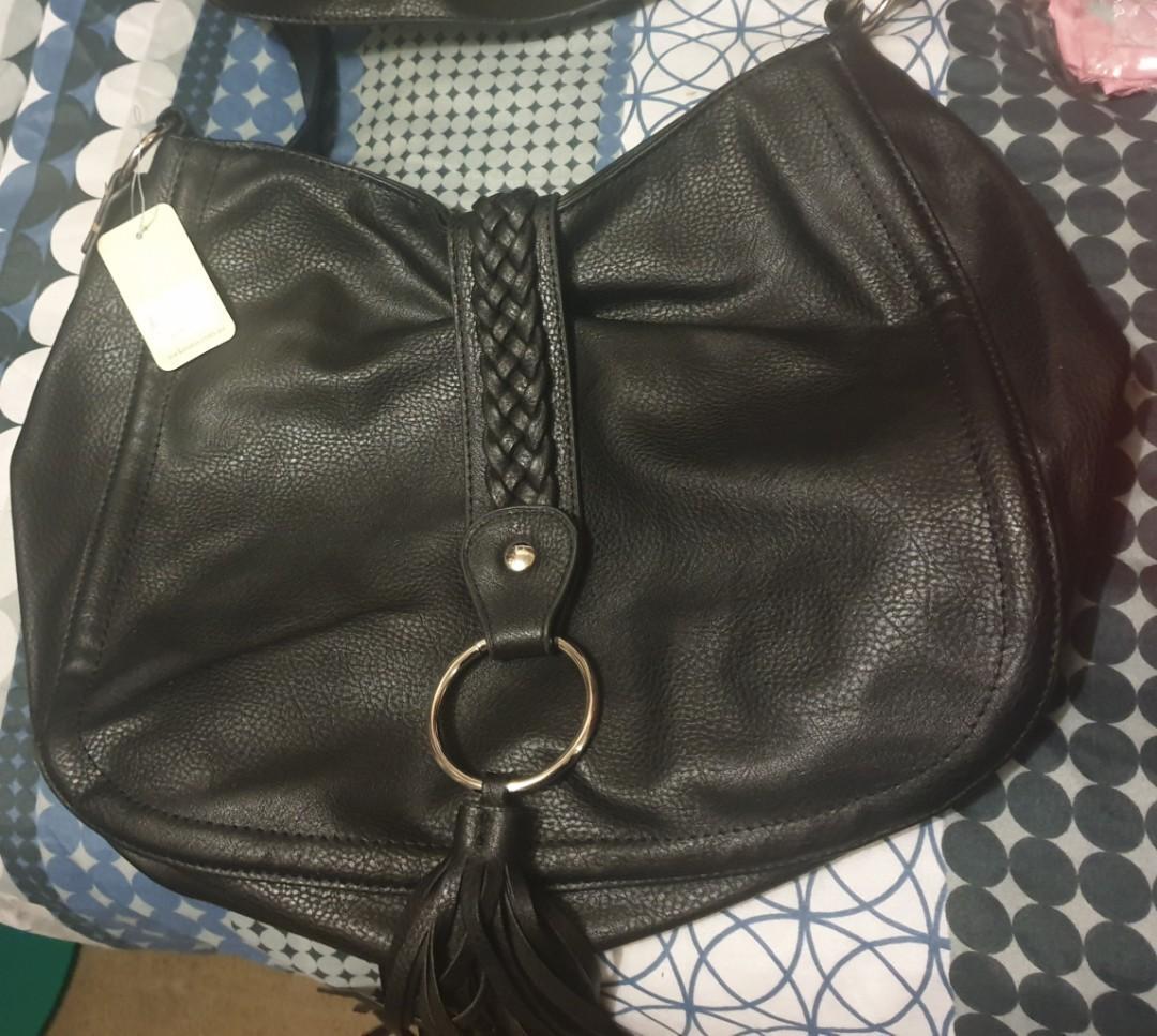 New handbag still has tag on it cost 50 selling for $30