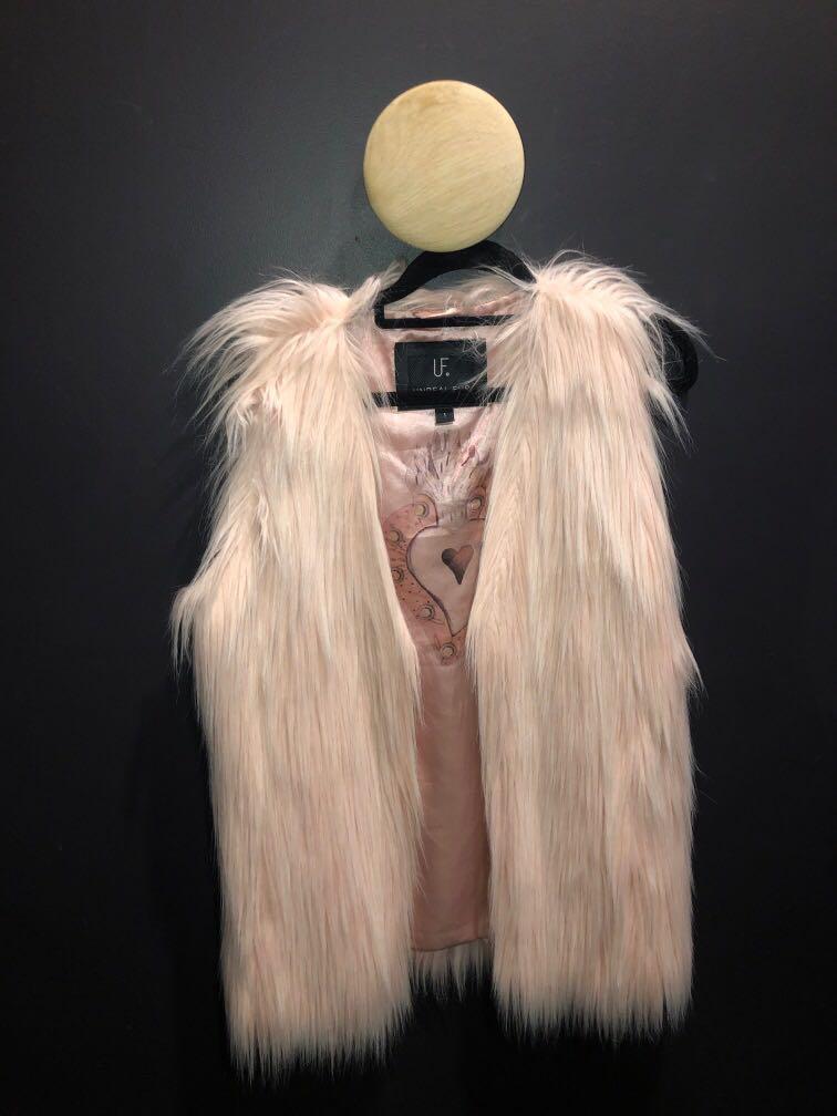 Unreal fur blush fur vest