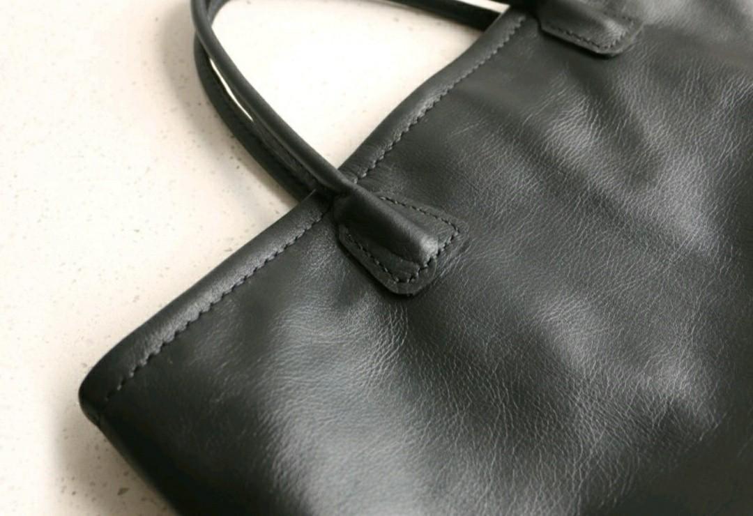 真皮黑色大容量手提肩背包
