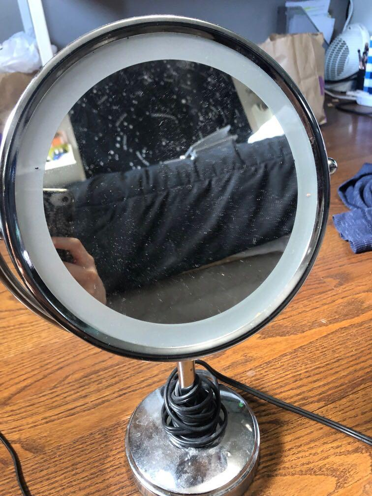 Beauty mirror with yellow ring light and magnifying