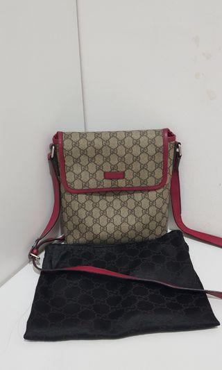 Gucci canvas sling bag