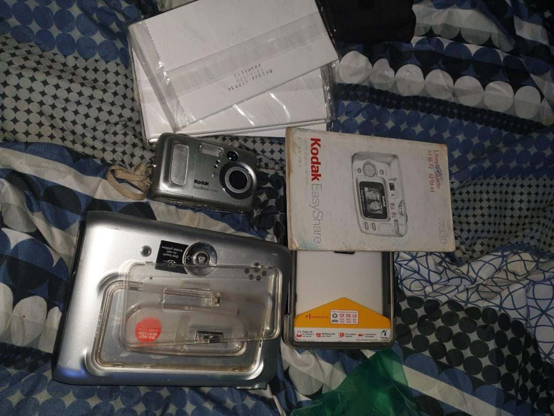 Kodak camera and printer and photo paper missing cords tho thats why going cheap