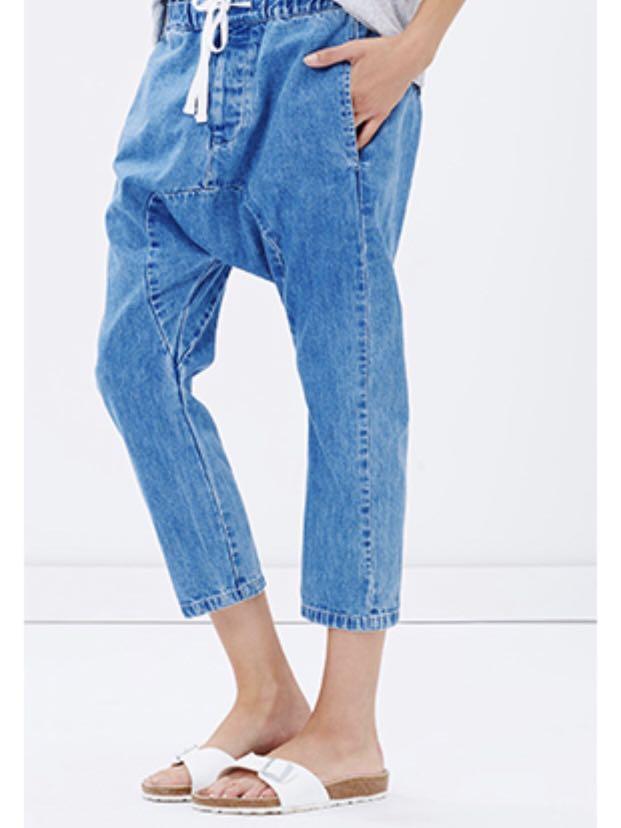 Assembly label dropped crotch jeans