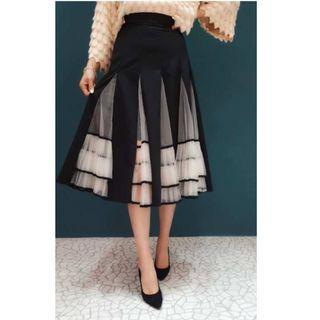 波浪造型拼接網紗中長裙