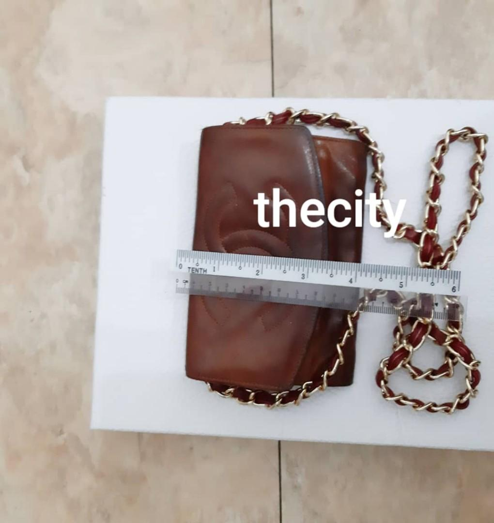 AUTHENTIC CHANEL CC LOGO LAMBSKIN LEATHER- ORGANIZER POUCH / WALLET- BROWN COLOR - HOLOGRAM STICKER & DATE OF PURCHASE STICKER INTACT - CLEAN INTERIOR, CAN CLEAN / TOUCH UP AT BAG SPA - GOLD HARDWARE- COMES WITH EXTRA ADD HOOKS & LONG STRAP
