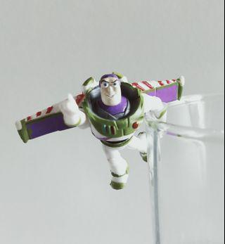 Toy Story Buzz Lightyear hanging on glass