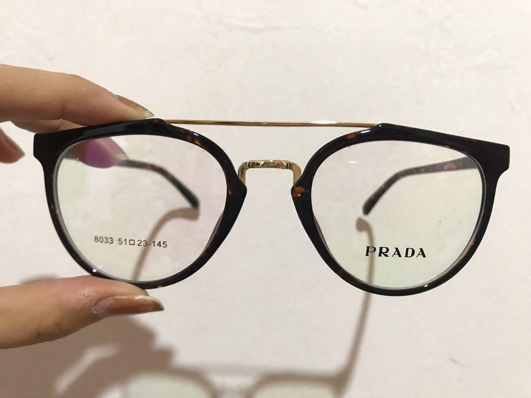 Frame kacamata prada aviator round motif leopard