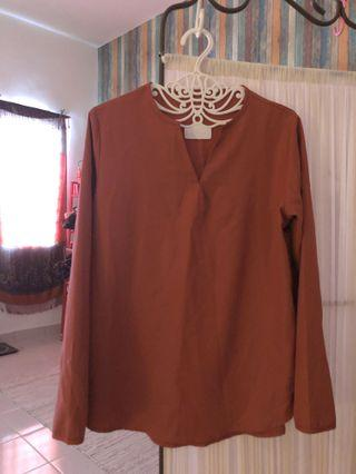 Blouse in orange butter