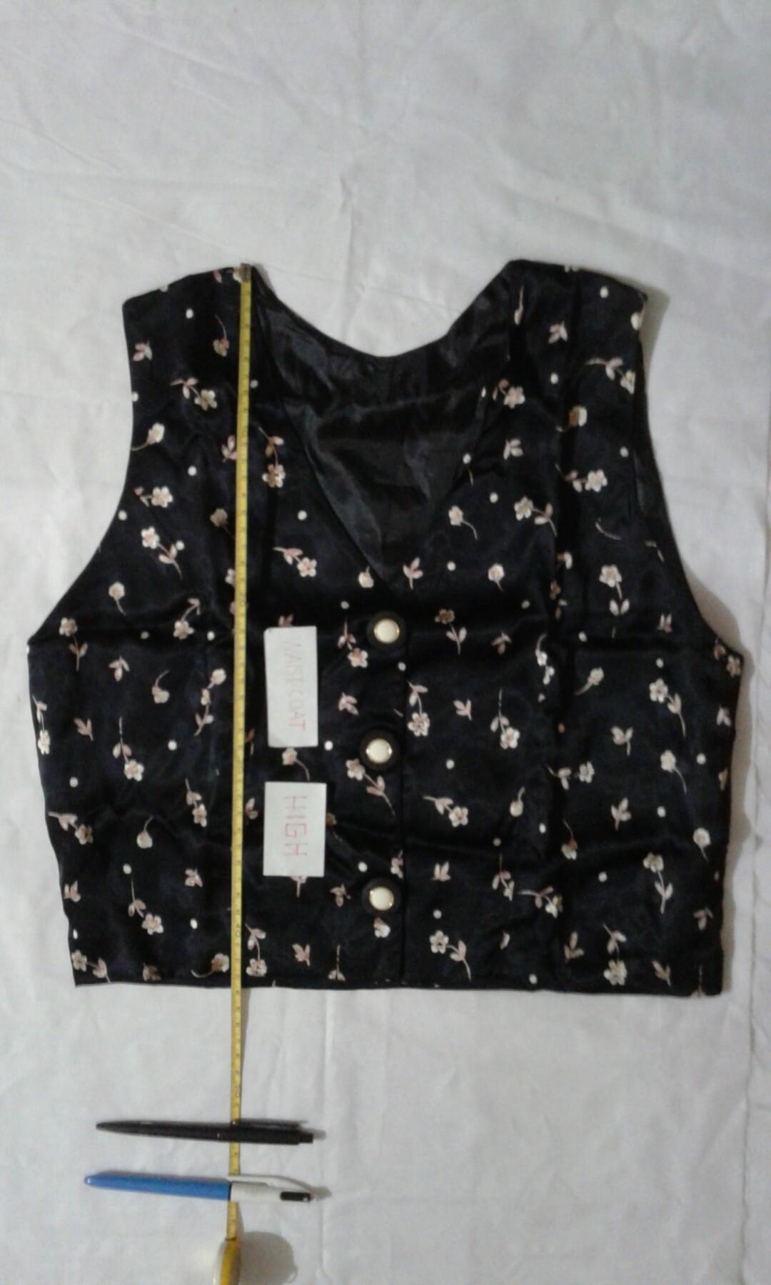 B) Waistcoat + long skirt puberty woman is black shine.