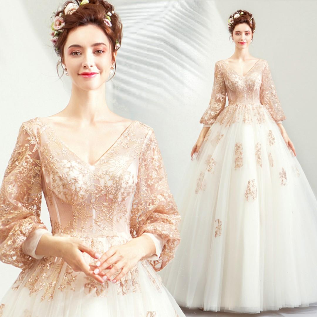 long sleeve white and gold wedding dress