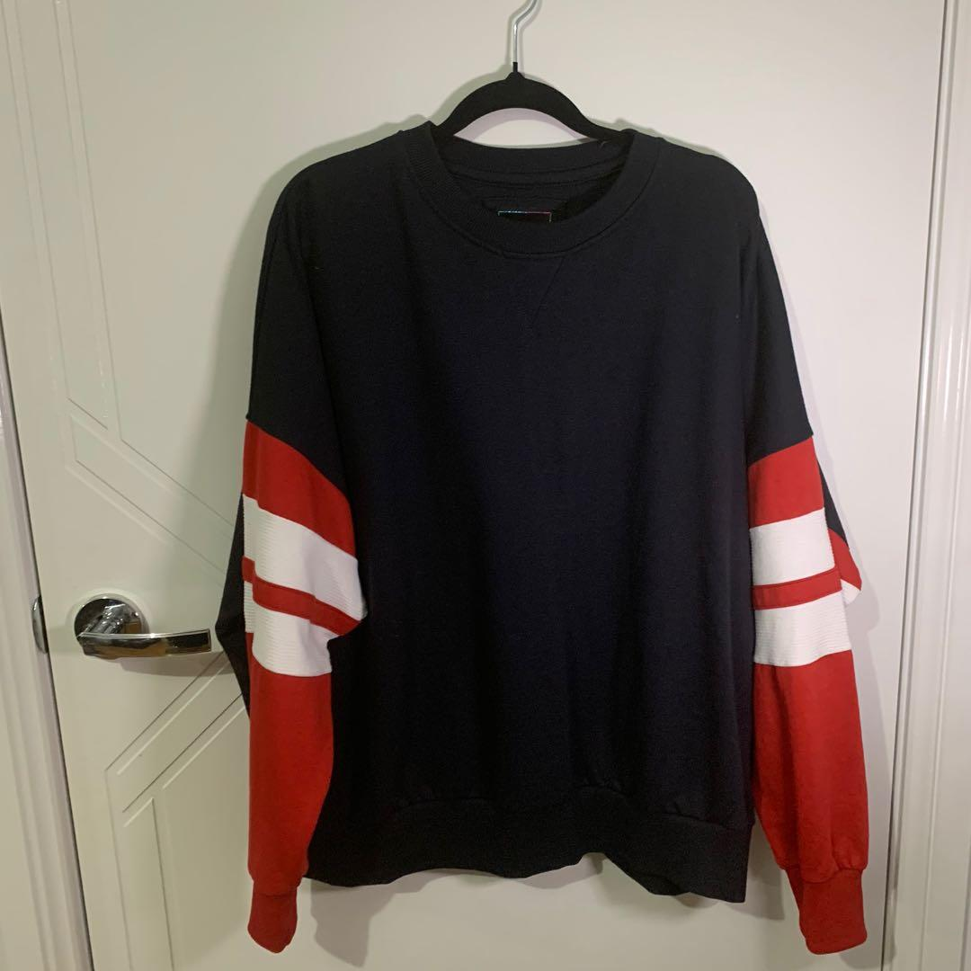 navy blue jumper sweater with red and white details
