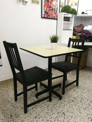 Small dining table with 2 IKEA STEFAN chair