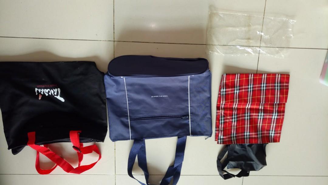 全新四個包每個皆NT$30,(黑包一個40*33公分,藍包一個46*33公分,格子包兩個30*30公分), 做環保,便宜賣!