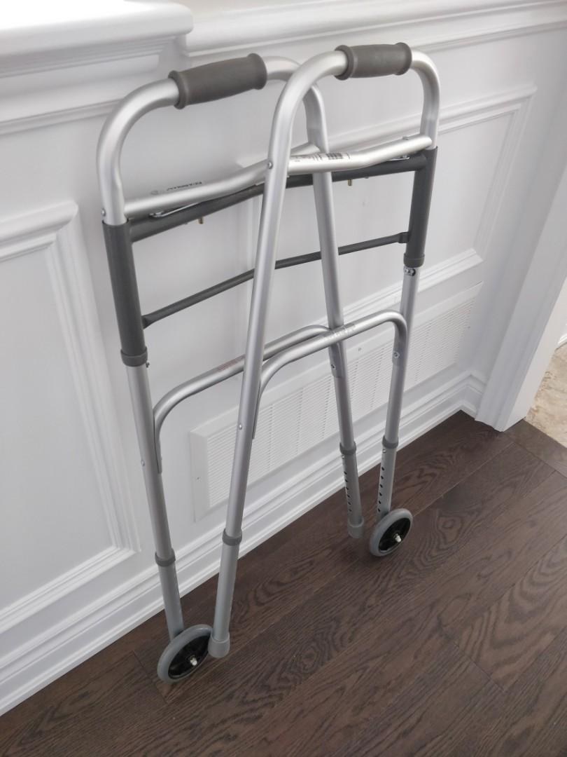 "Like NEW Medline two button folding walker with 5"" wheels"