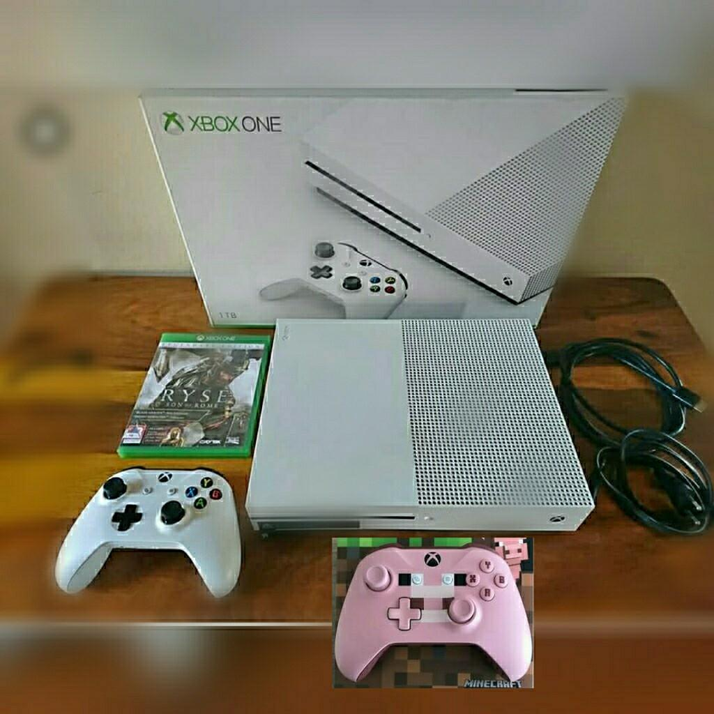 Xbox one s 1tb. With 2 controllers, free gameand headohones with hd microphone.