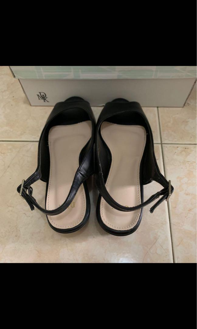 Almost new black wedges