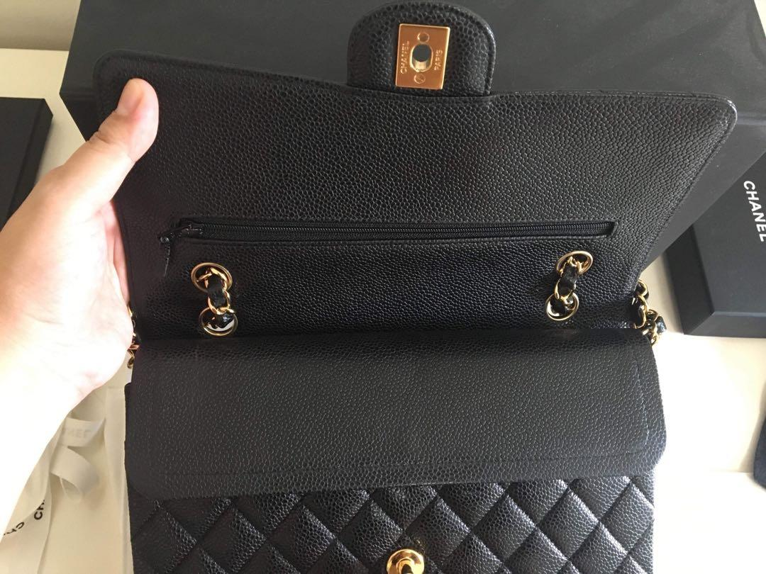 Authentic Chanel Medium Classic Flap Caviar black in Gold Hardware