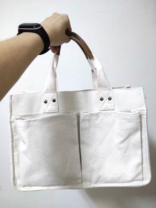 杏色手提包包