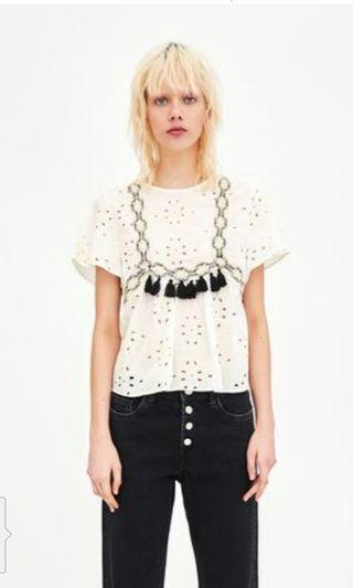 Embroidery  blouse with tassel