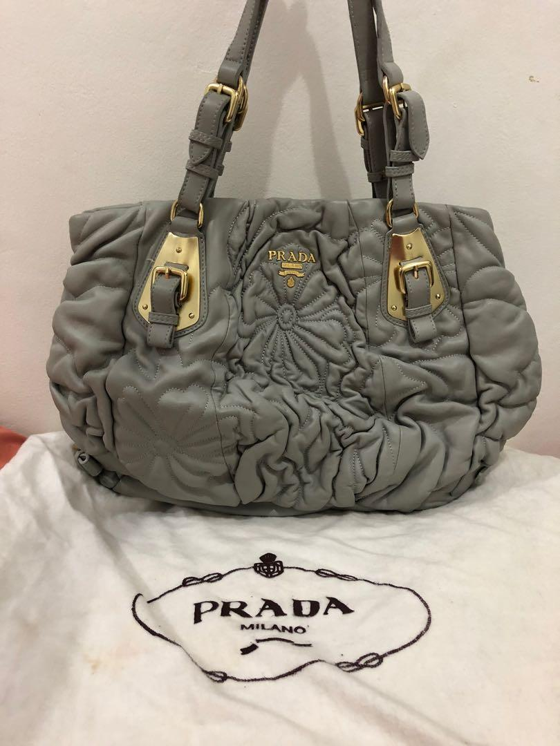 preloved - prada grey ori leather 30x31cm comes with card and dustbag.