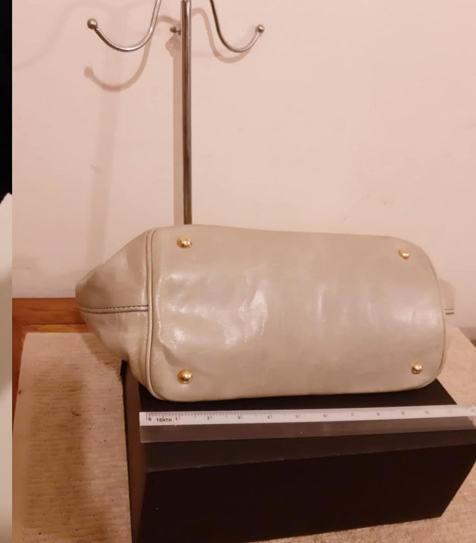 AUTHENTIC MIU MIU LAMBSKIN LEATHER MEDIUM TOTE BAG,  COMES WITH ITS ORIGINAL LONG STRAP FOR CROSSBODY SLING - GREY COLOUR- IN GOOD CONDITION,  CLEAN INTERIOR - (BOUGHT AROUND RM 6000+)  - SOLD