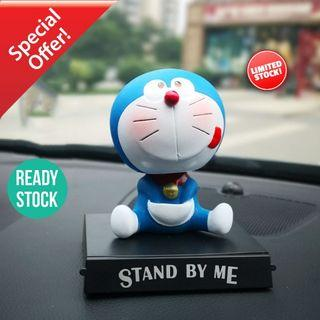 Cute Doreamon Tongue Out Shaking Head Car Toy