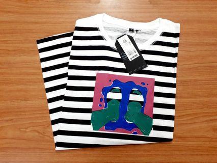 Kaos brand baca di label