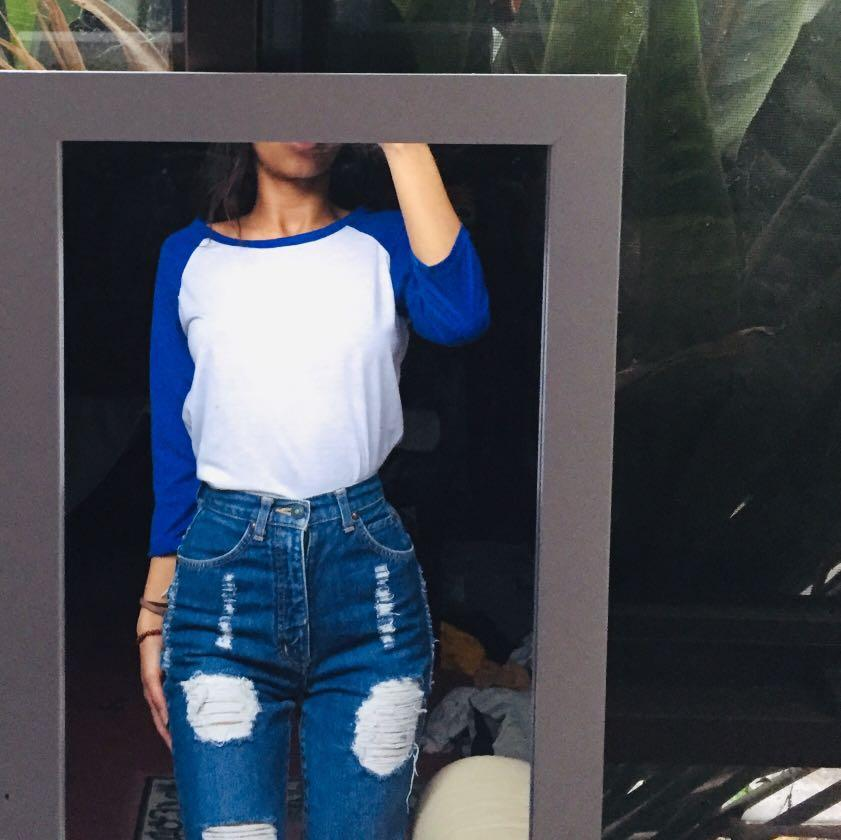 Blue and white varsity long sleeve top with cropped sleeves