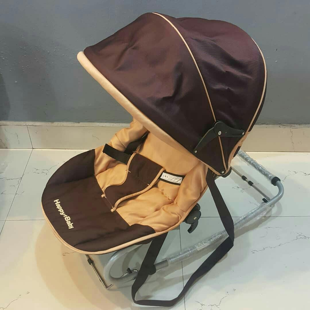 Happy Baby bouncer  rocking chair with canopy like new condition