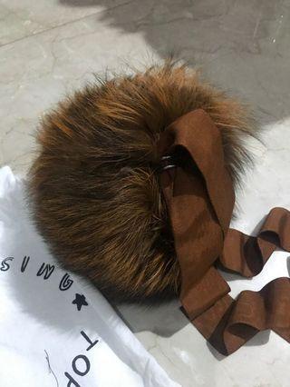 Top boutique fur round bag