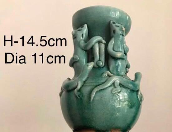 An extremely rare celadon crackled glazed cat lizard vase