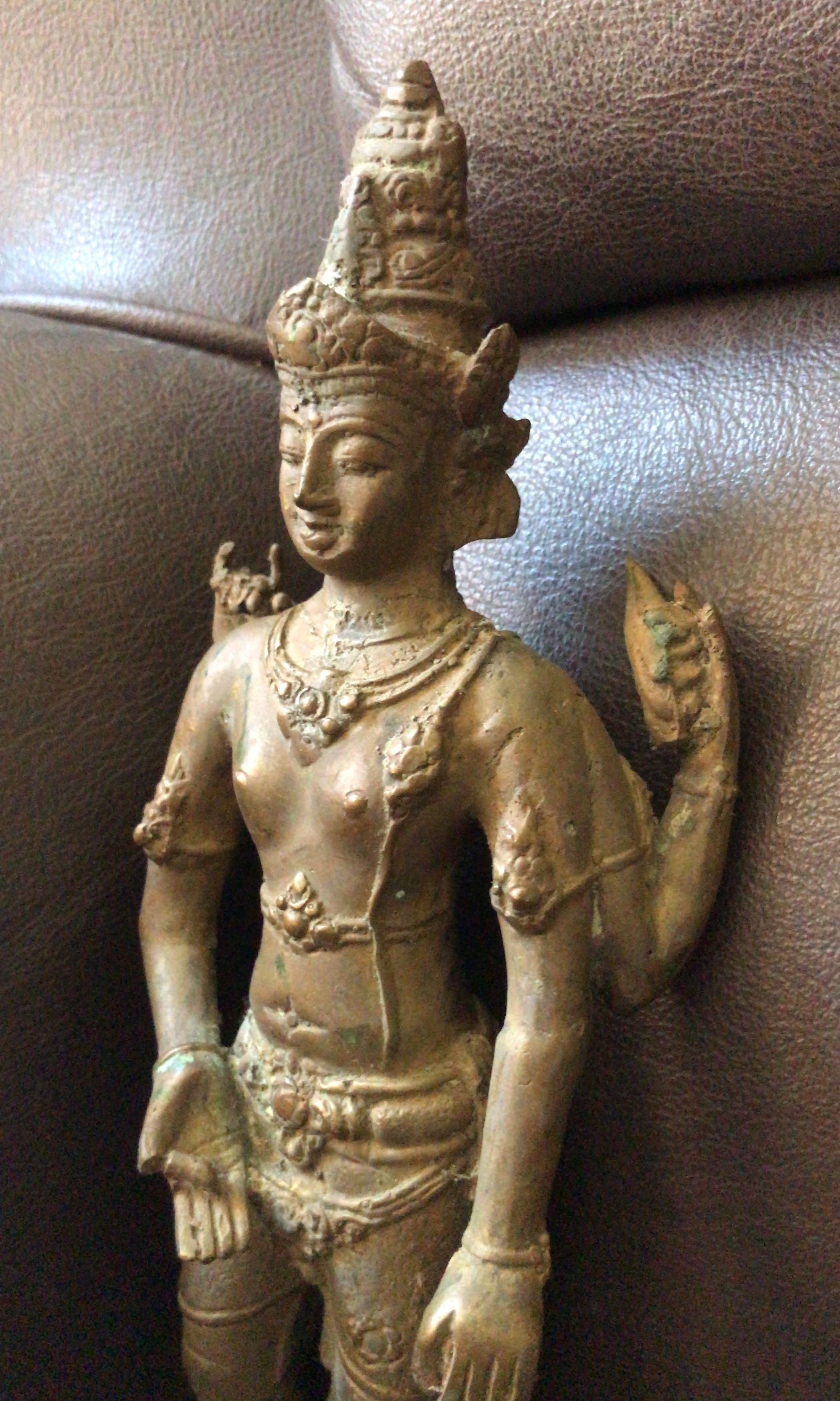 A bronze Indonesian figure Buddha statue