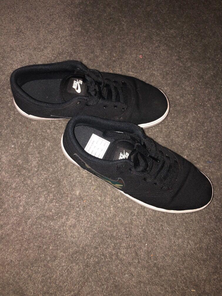 Black and camo Nike SB shoes size 6