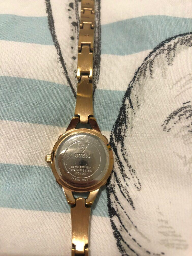 Guess women's rose gold and jewel watch with extra pieces for size adjustment *slight wear on band*