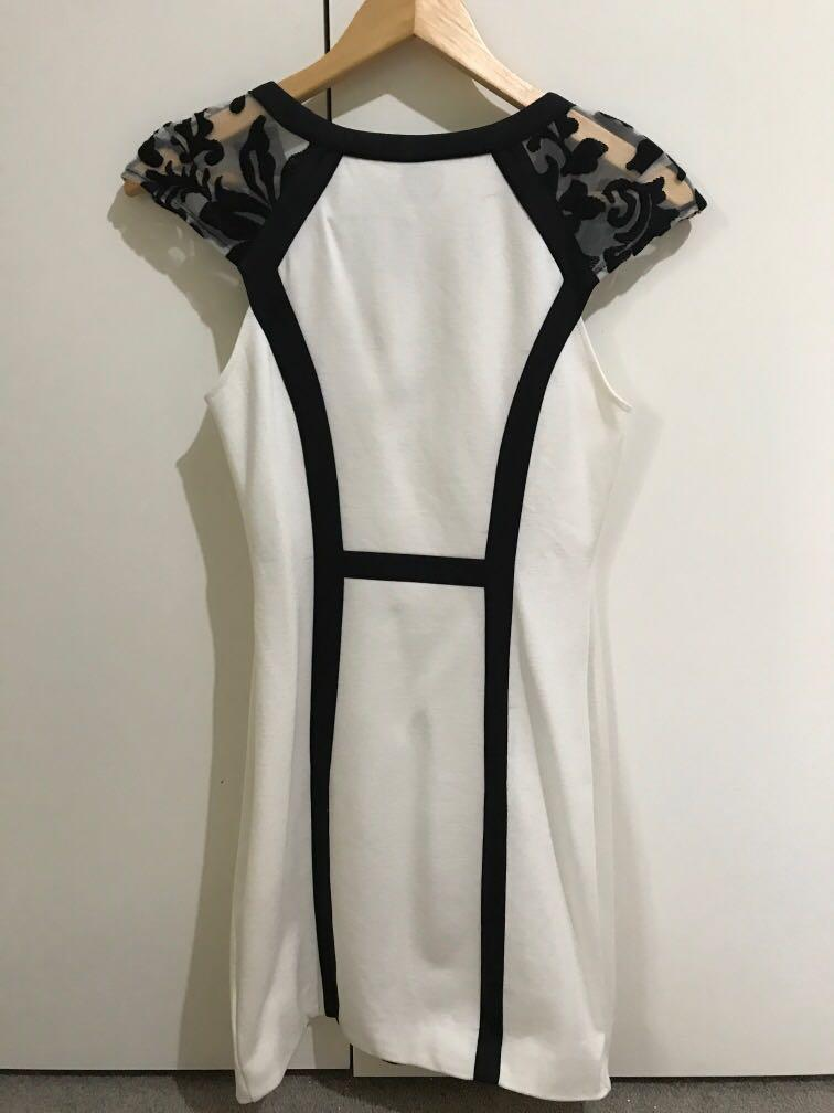 BNWT white minidress with black embroidery panel and sheer sleeves, size 8