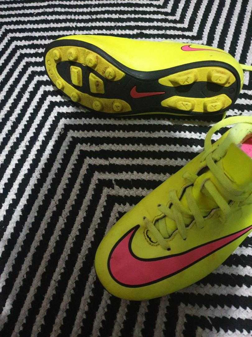 Neon yellow Mercurial with pink Nike tick soccer boots