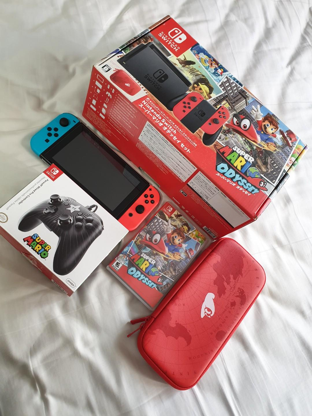 Nintendo Switch with Mario odyssey game and pouch