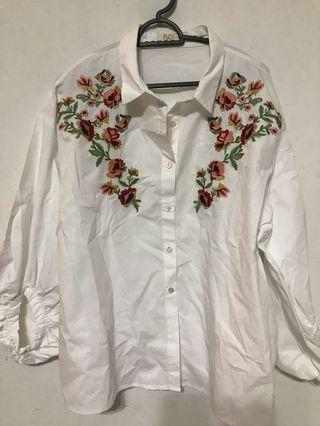 White top with embroidery