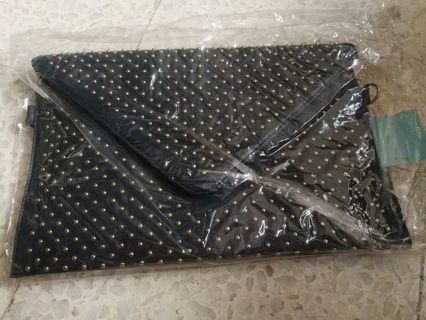 Studded envelope clutch