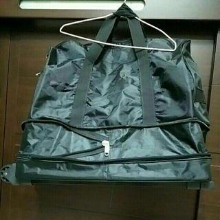黑色手拉手提兩用行李袋