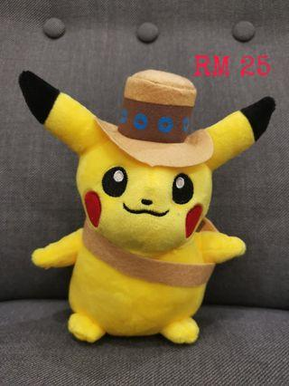 Pikachu plush toy with hat