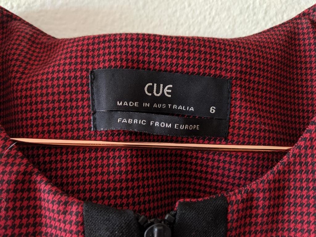 Cue houndstooth red and black peplum style zip front top