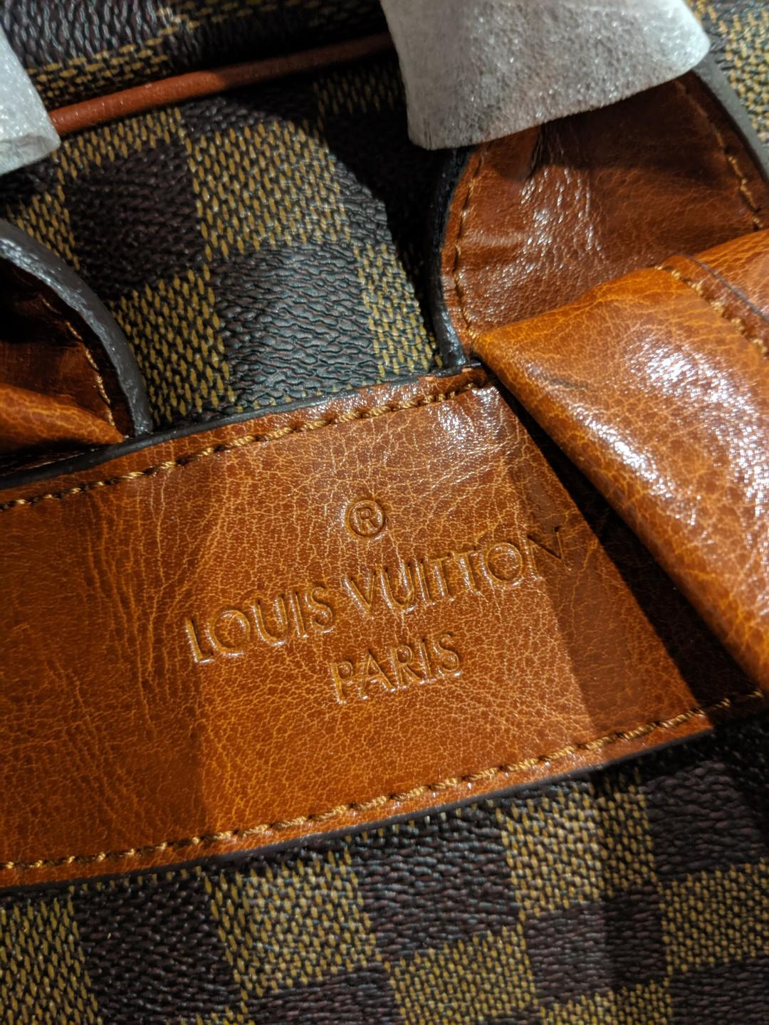 Louis Vuitton backpack in tan brown with gold zip closures