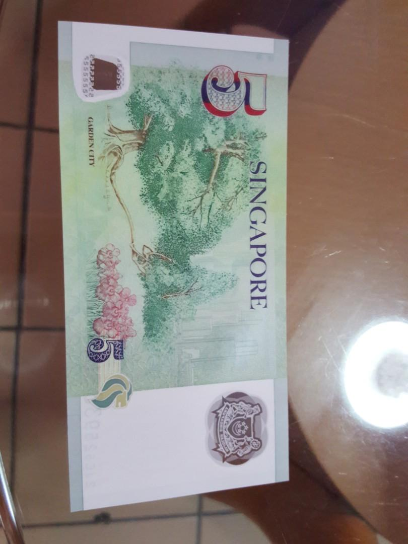 SG/$5/UNC/ SLIGHTLY INK MARK.