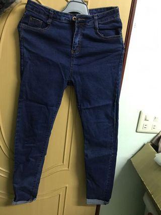 深藍色捲管牛仔長褲