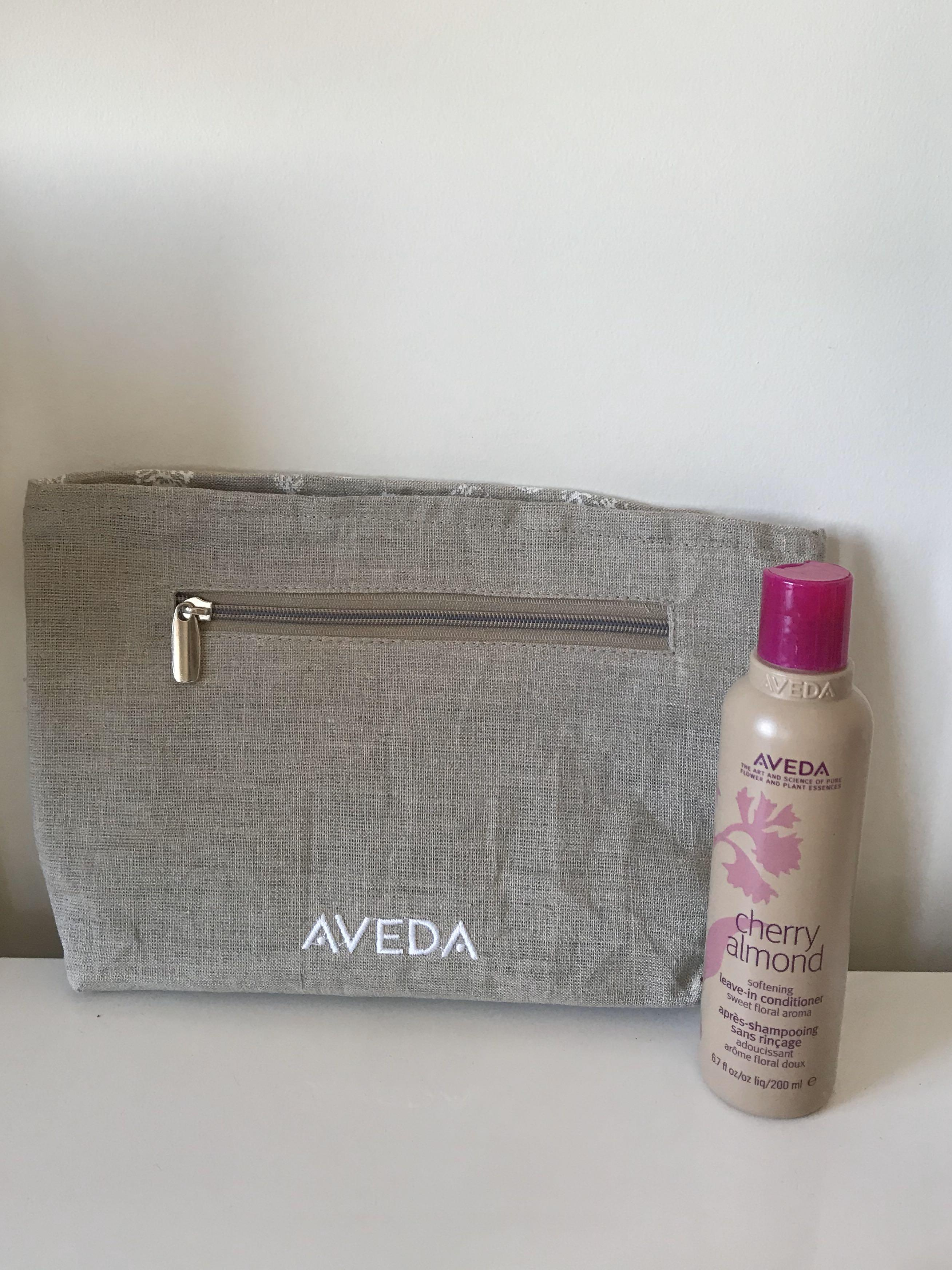 Aveda cosmetic pouch AND cherry almond leave in conditioner