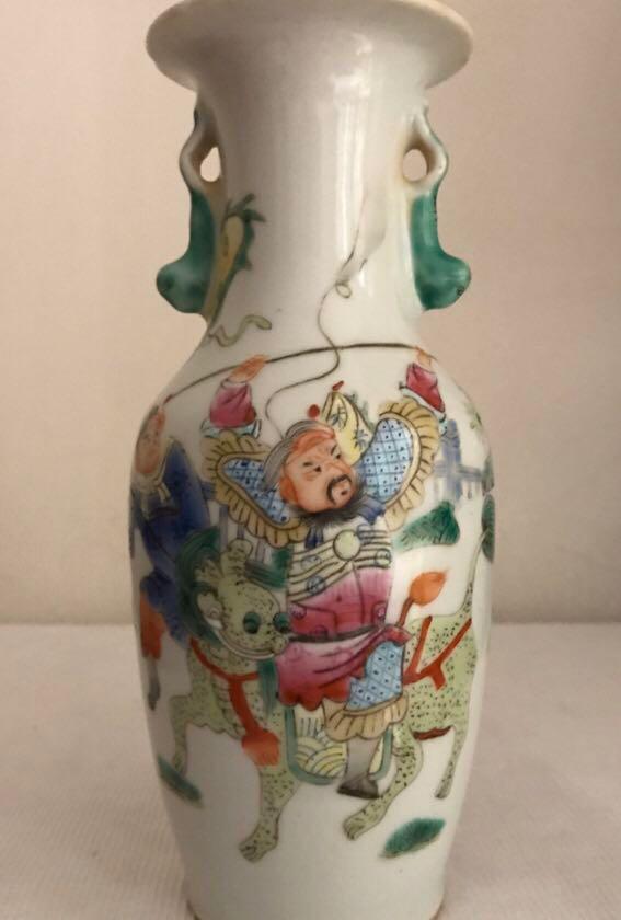 A bat and figural floral-rim vase