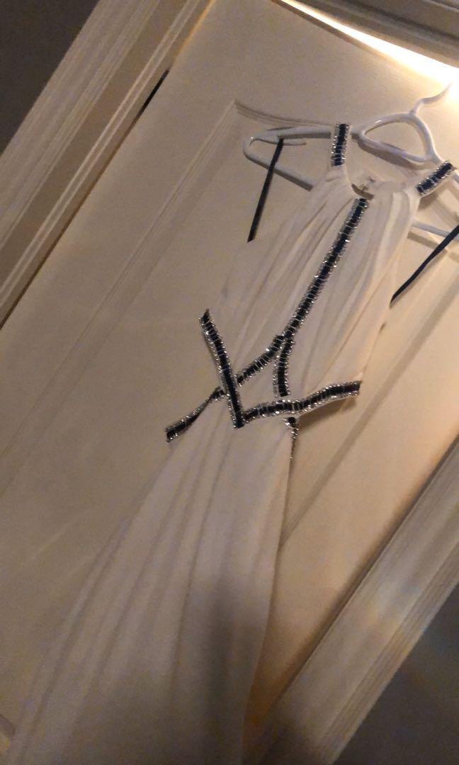 White long dress . Cut outs, bling , high neck , high slit