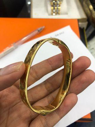 Lv gold bracelet
