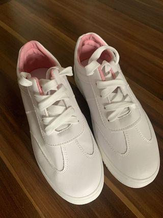 White shoes with pink inner cushion